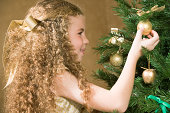 Girl decorating a Christmas tree