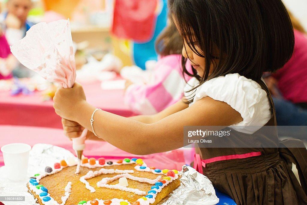 Girl Decorating Cake