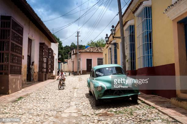 A girl descends to the street on her bicycle in Trinidad Cuba