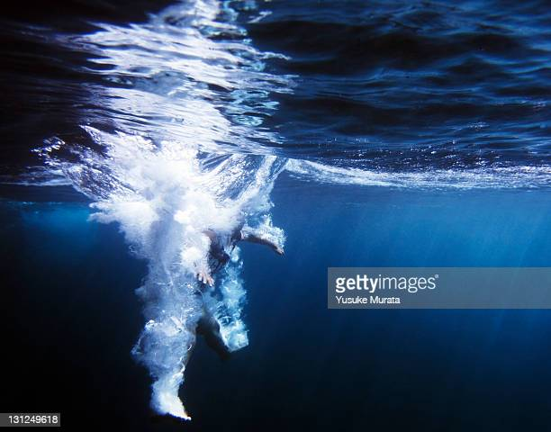 girl diveing into the sea, underwater