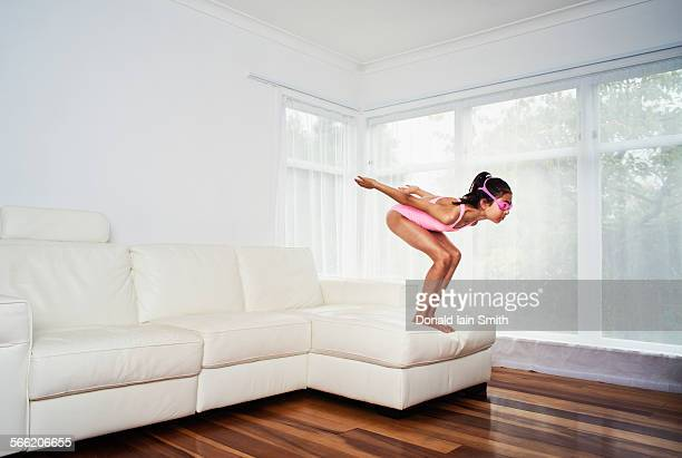 Girl dives from sofa