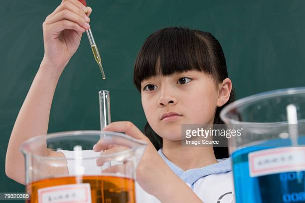 A girl doing a science experiment