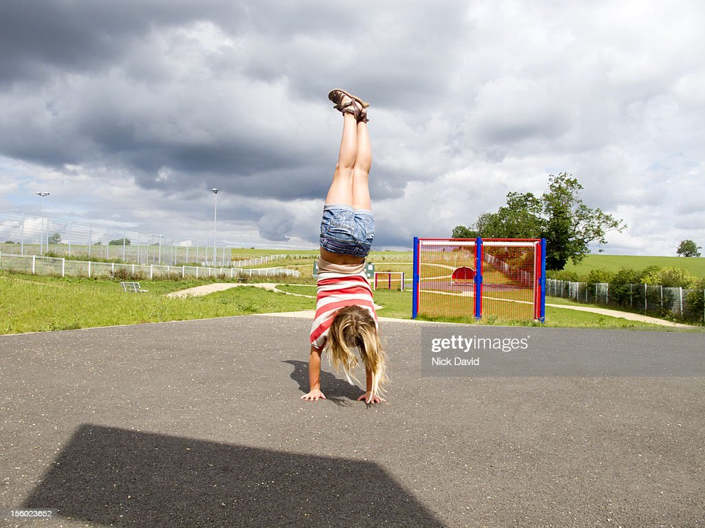 girl doing headstand : Stock Photo