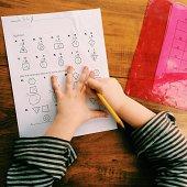 Girl (6-7) doing her homework