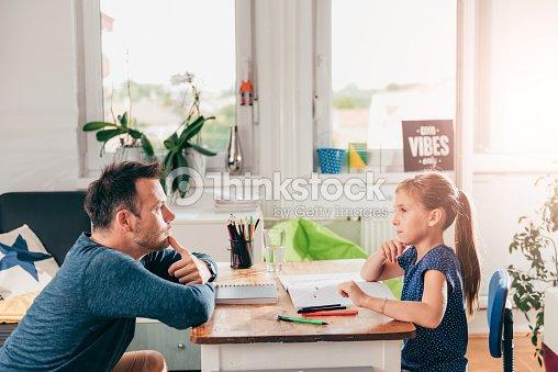 Girl Doing Homework In Sitting Room High-Res Stock Photo