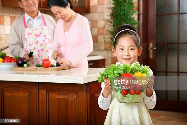 Girl doing housework with her grandparents
