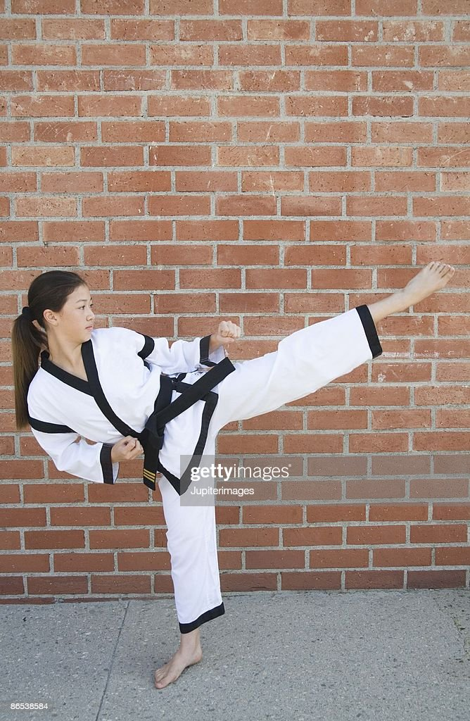 Girl doing martial arts : Stock Photo