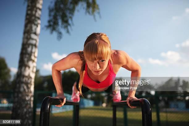 Girl doing push-ups outdoor workout