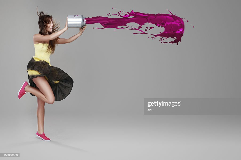 Girl doing splash with a bucket of paint : Stock Photo