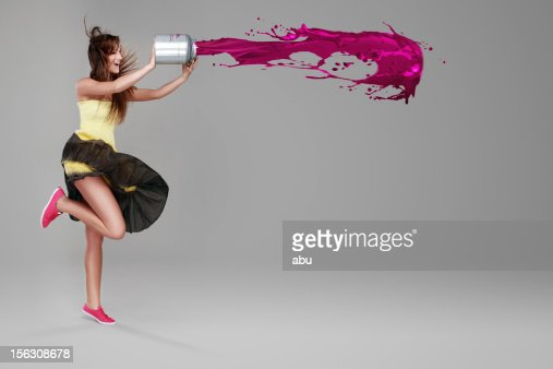 Girl doing splash with a bucket of paint