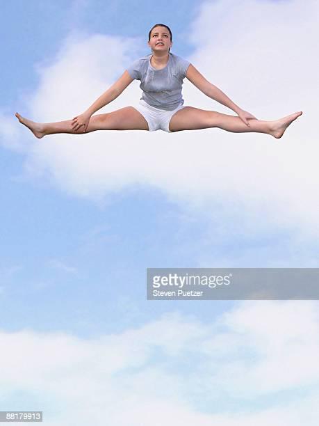 Girl doing splits in sky