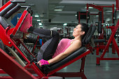 Girl doing the leg press at the gym