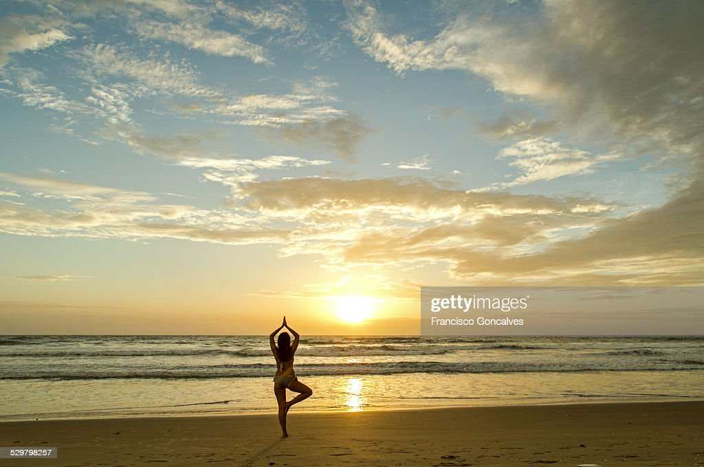 Girl doing yoga in a Gambia bech