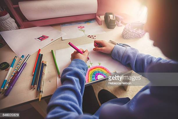 girl drawing at her desk