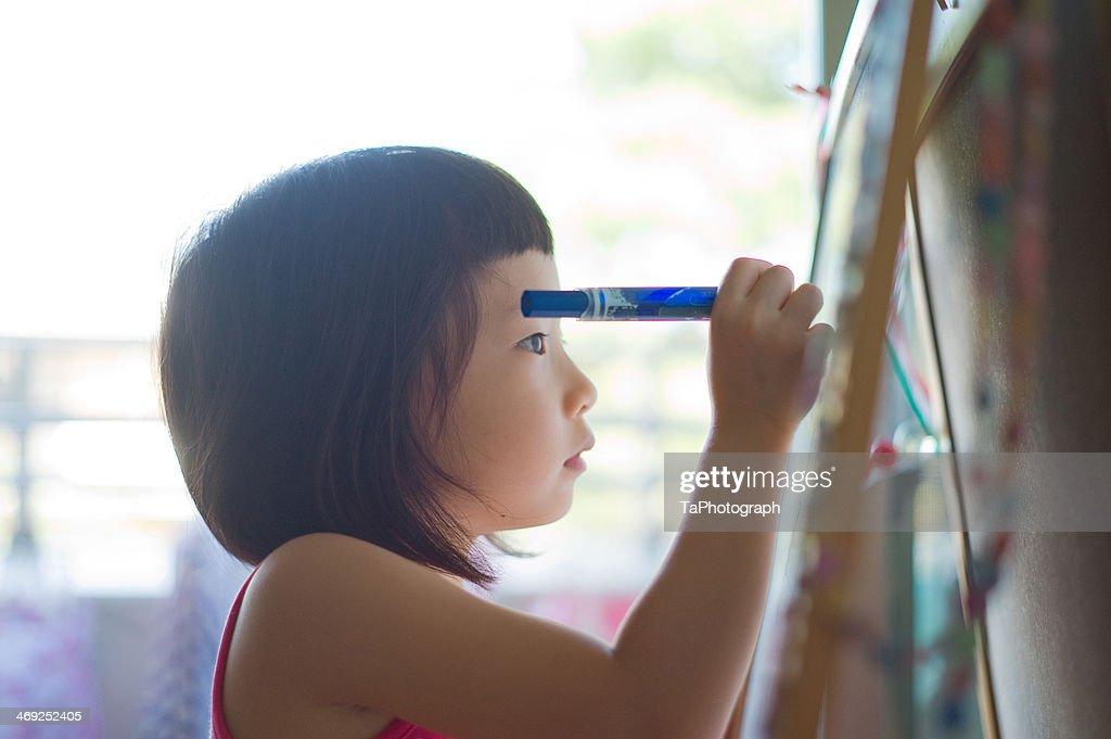 Girl drawing ideas : Stock Photo