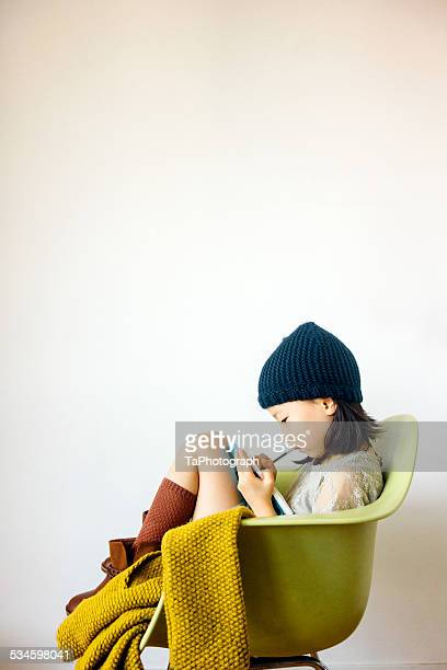 Girl drawing in an armchair