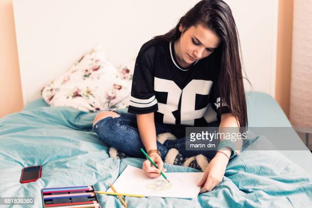 Girl drawing in coloring book