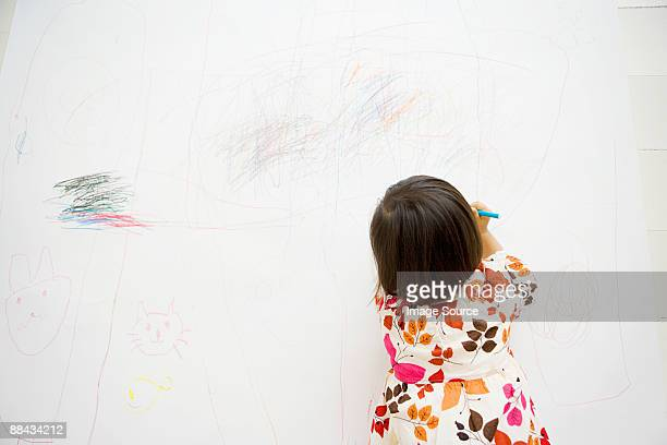 Girl drawing on a wall