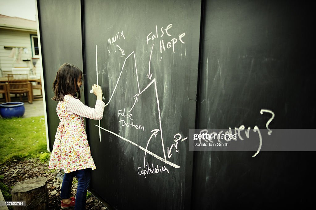Girl drawing on chalk board
