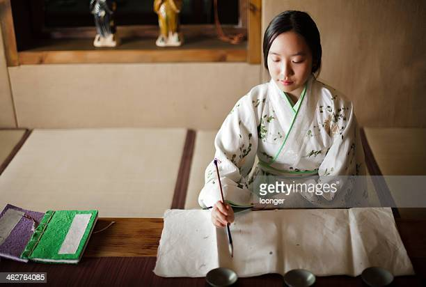 Girl drawing Traditional Chinese Painting