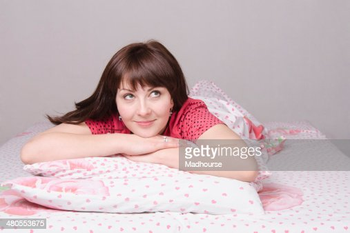 girl dreams lying in bed : Stock Photo