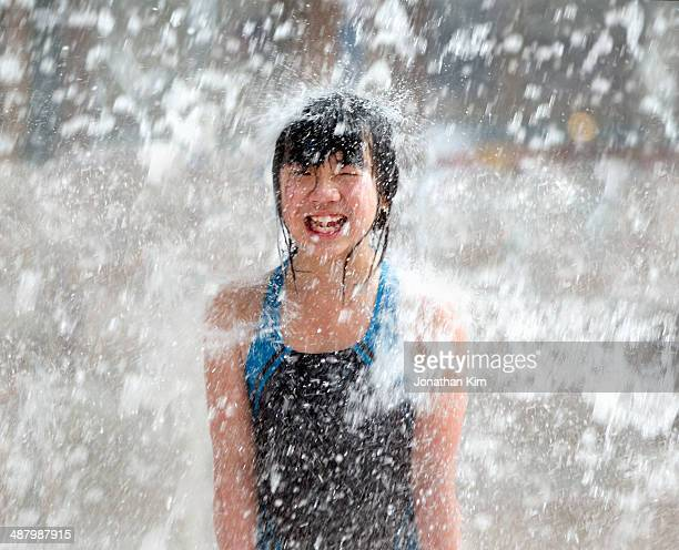 Girl drenched in waterfall.