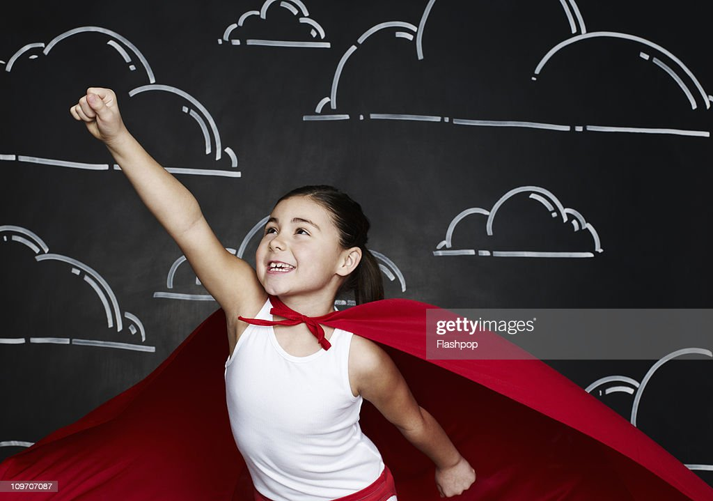 Girl dressed as a superhero : Stock Photo
