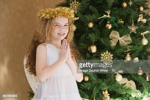 Girl dressed as an angel at Christmas : Stock-Foto