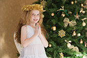 Girl dressed as an angel at Christmas