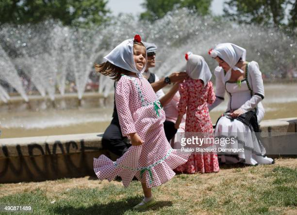 A girl dressed as 'chulapa' dance during the San Isidro festivities at Pradera de San Isidro park on May 15 2014 in Madrid Spain During the...
