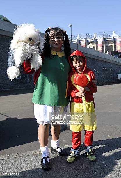 A girl dressed as 'La Chilindrina' and a boy dressed as 'El Chapulin Colorado' characters of the sitcoms 'El Chavo del Ocho' and 'El Chapulin...