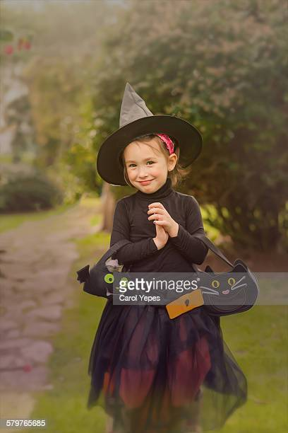 Girl (3-5) dressed as witch in  halloween
