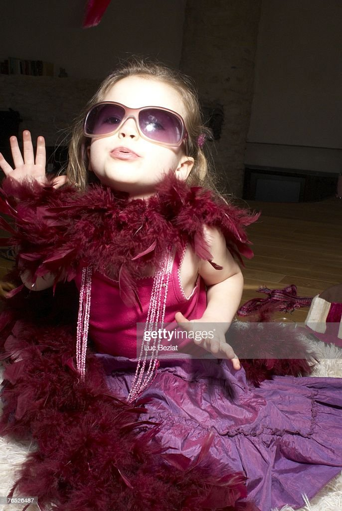 Girl (2-4) dressed for party, acting like a diva. : Stock Photo