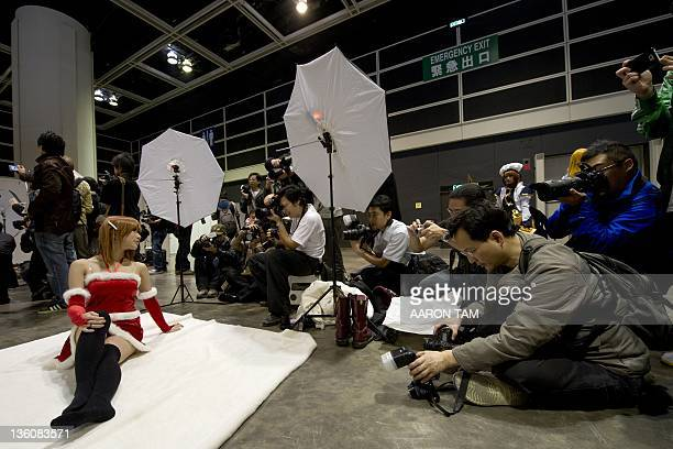 A girl dressed in a Christmasthemed cosplay costume poses for photos at the 10th Asia Game Show 2011 in Hong Kong on December 23 2011 Video game...