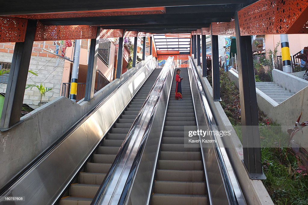 A girl dressed in New Israelites habits uses the escalators in '20 de Julio' neighborhood in the Comuna 13 slums on January 5, 2013 in Medellin, Colombia. The stairway is divided into six sections and has a length of 1,260 feet. An escalator goes up and a second goes down.Residents used to climb hundreds of steps to get home from the bottom of the hill, but the journey now takes just 6 minutes. Comuna 13 is the most notorious slums of Medellin with violence occurring everyday.