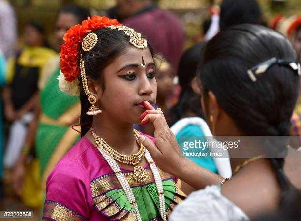 A girl dressed in traditional attire for dance program during Makkala Hanna Children Festival at Cubbon Park on November 12 2017 in Bengaluru India...