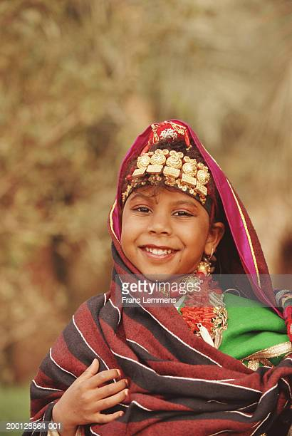 Girl (6-8) dressed in traditional Berber costume, portrait