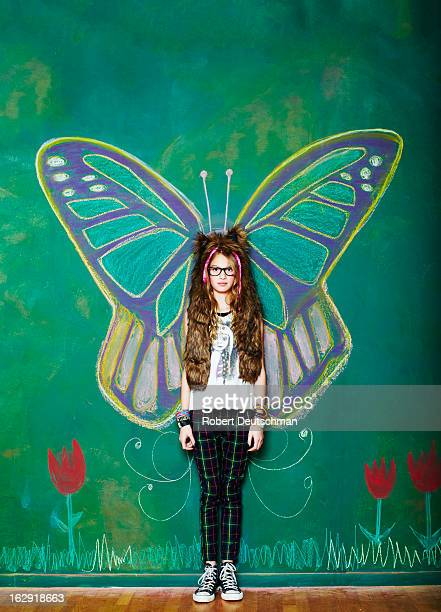 A girl dressed up as a butterfly.
