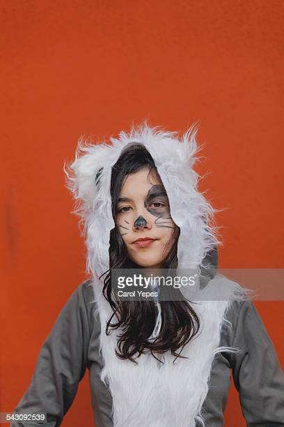 Girl dressed up in a raccoon costume