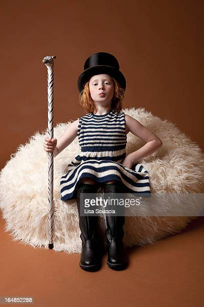 Girl dressed up with top hat and cane