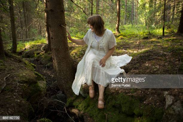 Girl dressed white in forest