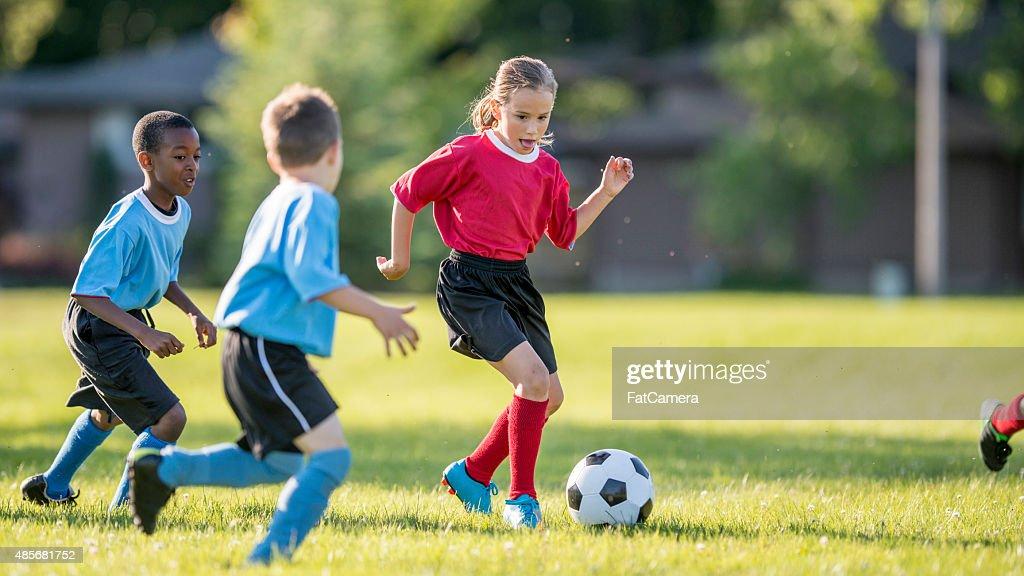 Girl Dribbling a Soccer Ball : Stock Photo