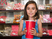 A girl drinking a soft drink