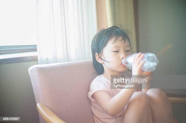 Girl drinking bottled water