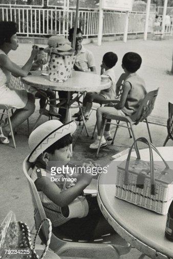 Girl drinking from bottle : Stock Photo