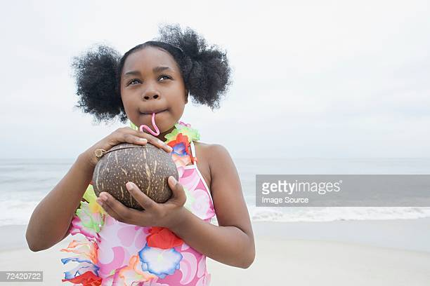 Girl drinking from coconut