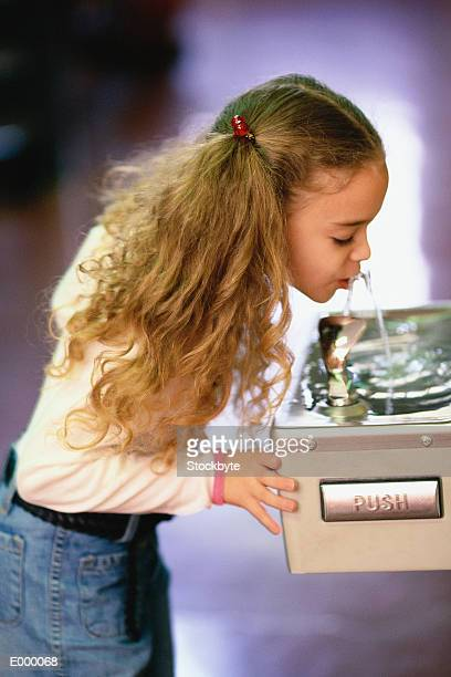 Girl drinking from water fountain