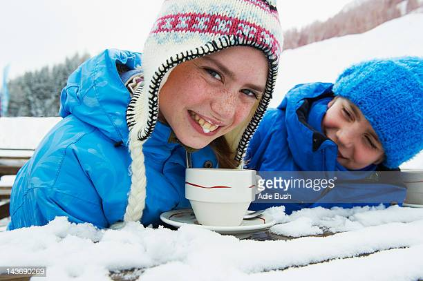 Girl drinking hot chocolate in snow