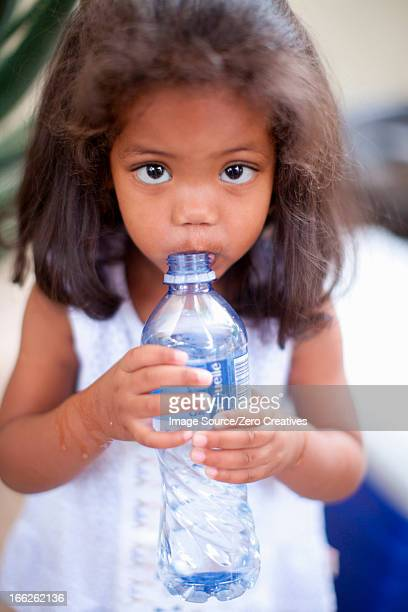 Girl drinking out of water bottle