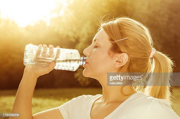 Girl drinking water after exercise